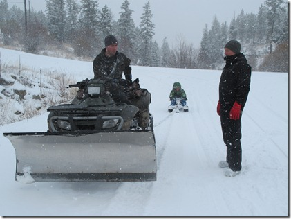 RBuchanan photo Neigbour Dave pauses with Mark from giving son Jordan a sleigh ride